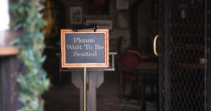 Please wait to be seated banner